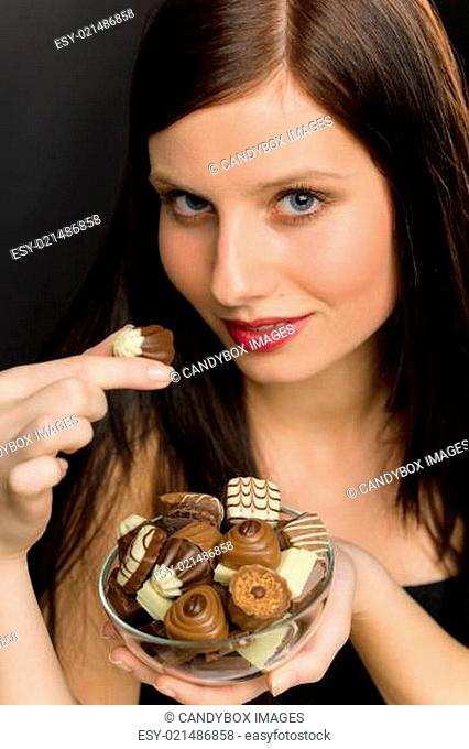 Chocolate - portrait young woman enjoy candy