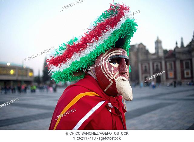 A dancer from Chocaman, Veracruz, dressed as an European, dances the Danza de los Santiagos at the pilgrimage to Our Lady of Guadalupe Basilica in Mexico City