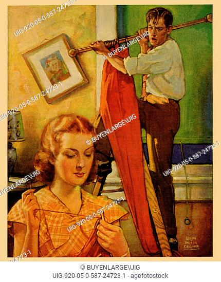 Wife sews while a man hangs a picture 1936