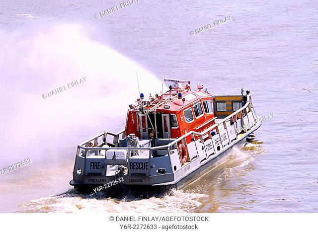 River Thames Fire and Rescue Boat in action near Lambeth Bridge in the heart of London, England