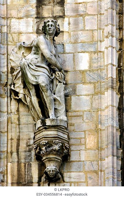 a statue of a women in the front of the duomo's church