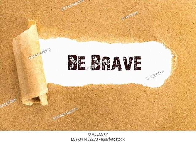 The text Be Brave appearing behind torn brown paper
