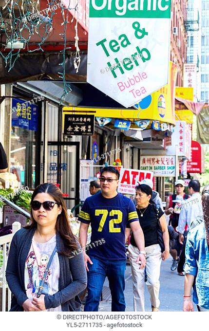 New York City, NY, USA, Crowd of Chinese People Walking on Street in Chinatown Neighborhood, with Store Signs