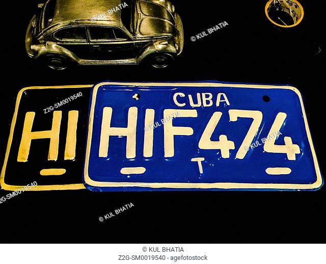 Two license plates for motorcycles from Cuba on display in Ontario, Canada