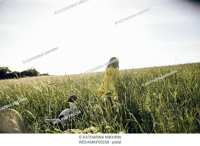 Little girl and dog in nature