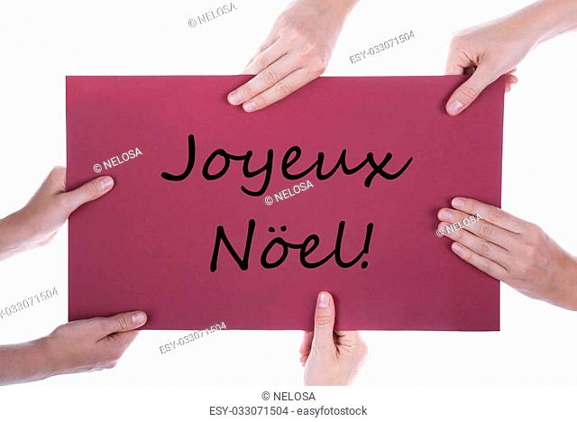 Many Hands Holding a Red Sign with the French Words Joyeux Noel which means Merry Christmas