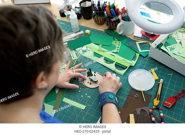 Craftswoman assembling diorama