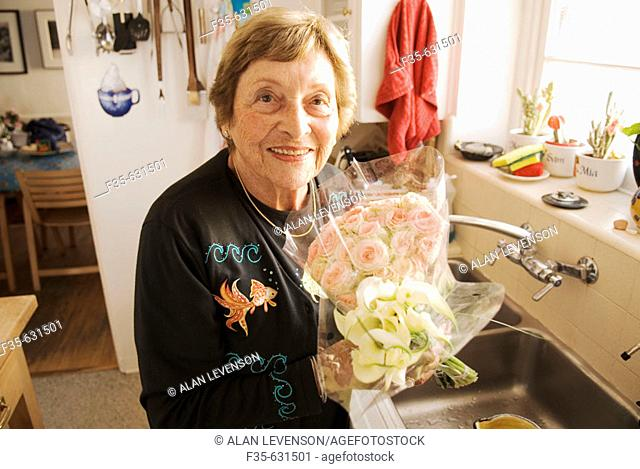 Grandmother in Kitchen with Flowers