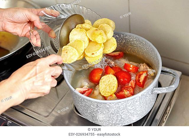 Add potato to the cooking in pan