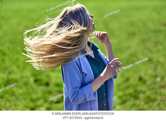Waakirchen, Bavaria, Germany, lively woman on meadow