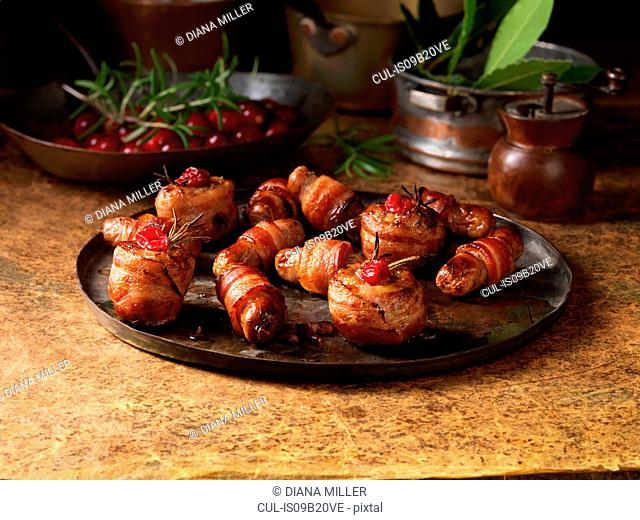 Christmas, celebration food, garnish selection, pigs in blankets, cranberries, rosemary
