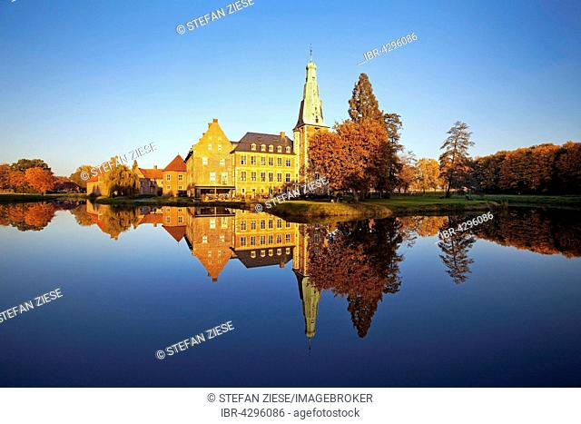 Raesfeld Moated Castle reflected in the water, Hohe Mark Nature Park, Westmünsterland, Münsterland, North Rhine-Westphalia, Germany