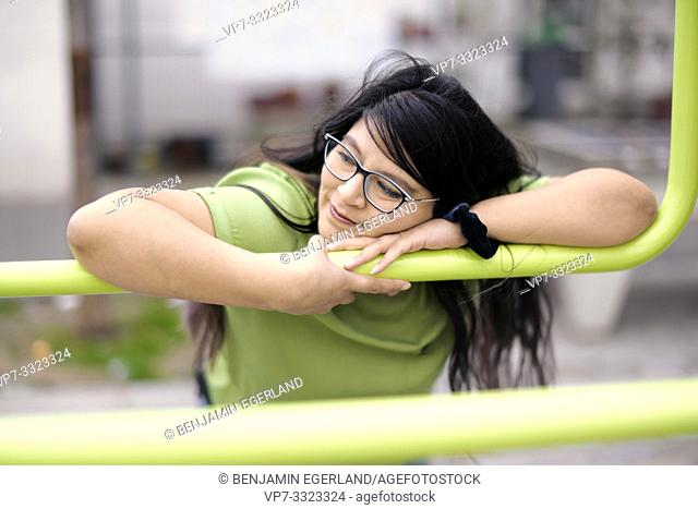 sanguine relaxed obese woman cuddling with metal in city, in Paris, France