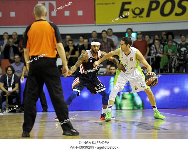 Munich's Malcolm Delaney (L) and Malaga's Sergi Vidal vie for the ball during the Basketball Euroleague Gruppe C match between Bayern Munich and Unicaja Malaga...