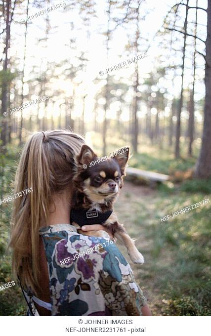 Girl with dog in forest