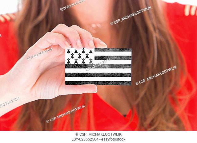 Woman showing a blank business card