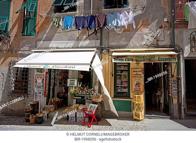 Shops on the main road, hanging laundry in front of windows, fishing village of Vernazza, Cinque Terre, La Spezia Province, Parco Nazionale delle Cinque Terre