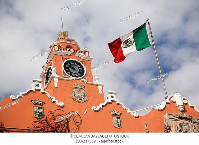 Bell Tower and the Mexican flag of the Palacio Municipal and Ayuntamiento-Town Hall in Zocalo at the historic center, Merida, Yucatan Province, Mexico
