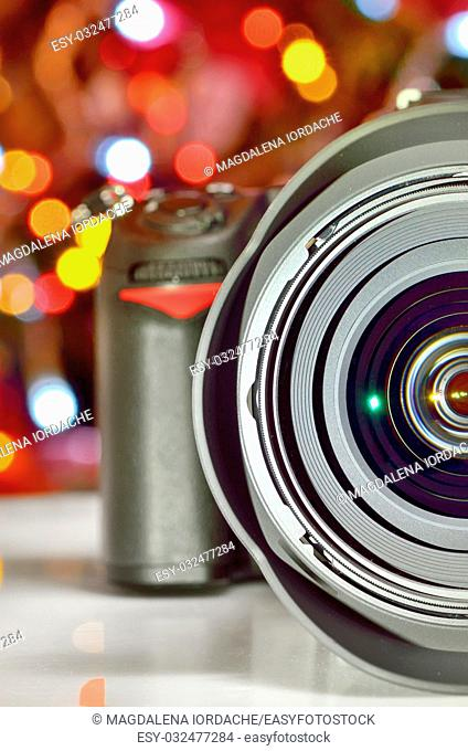 Close up view of digital camera on christmas lights
