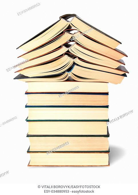 Stack of open and closed old books isolated on white background