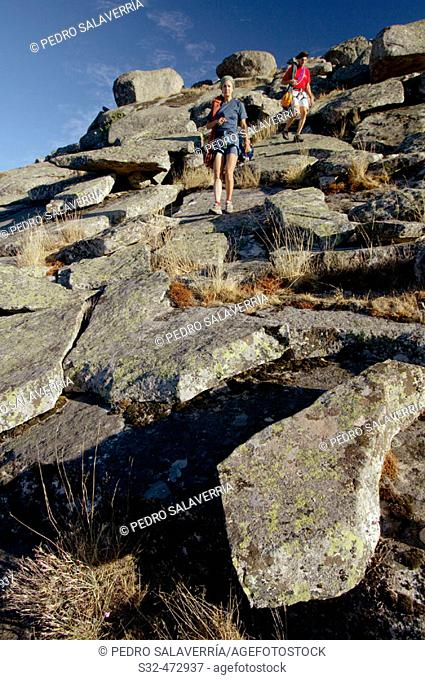 Climbers descending from Pico de La Miel, La Cabrera. Madrid province. Spain