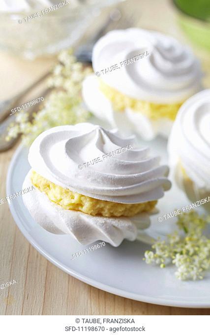 Meringues filled with elderflower cream