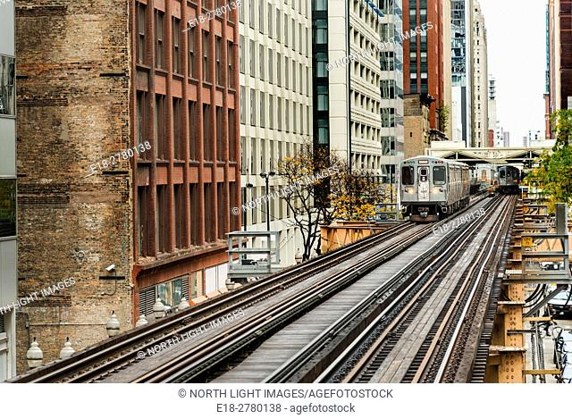 SA, IL, Chicago. Train leaves the station on the elevated tracks in 'The Loop' section of the transit system. Also known as the L Train