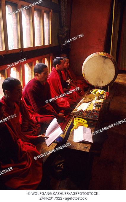 BHUTAN, PARO, MONASTERY, MONKS CHANTING