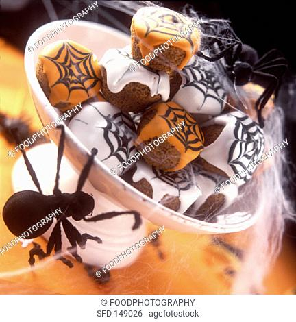 Halloween muffins with cobweb icing in a bowl