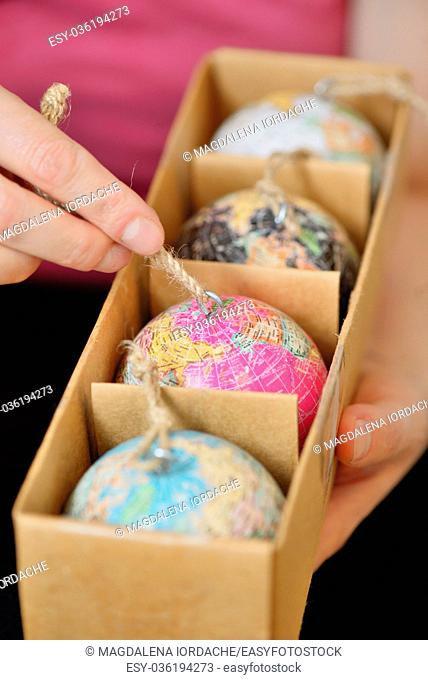 Christmas balls shaped as globe or planet in box