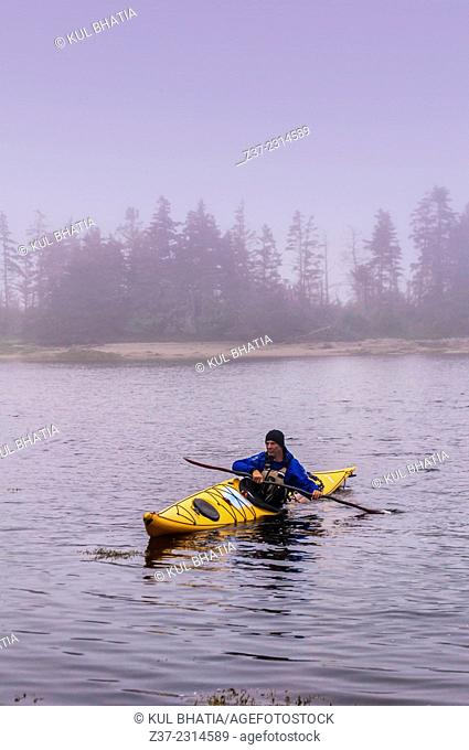 A lone kayaker in bad weather, Halifax, Nova Scotia, Canada