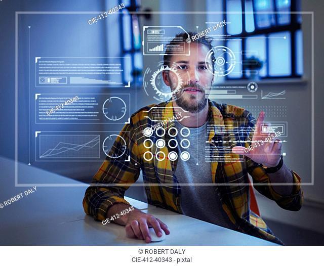 Businessman using futuristic hologram computer