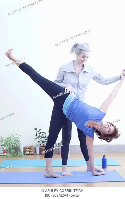 Women practising yoga