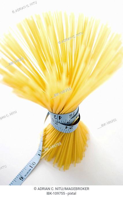 Spaghetti with measuring tape