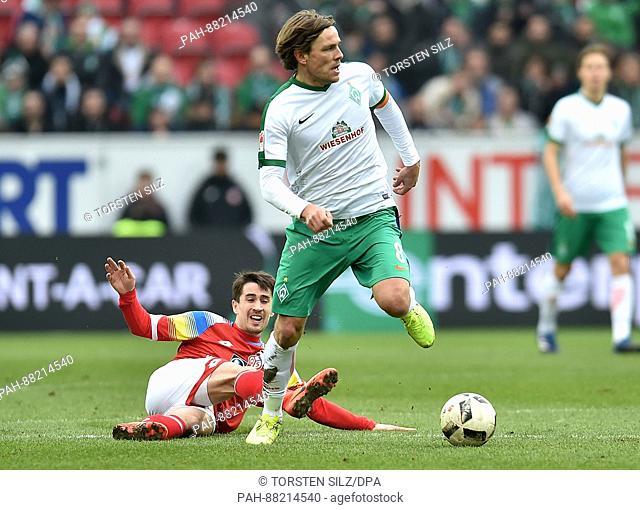 Bremen's Clemens Fritz evades a challenge from Mainz's Bojan Krkic during the German Bundesliga soccer match between FSV Mainz and Werder Bremen in the Opel...
