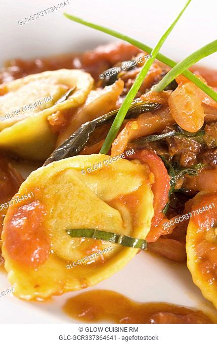 Close-up of meat and tortellini