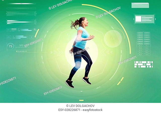 sport, fitness, technology, motion and people concept - happy smiling young woman jumping in air over green background