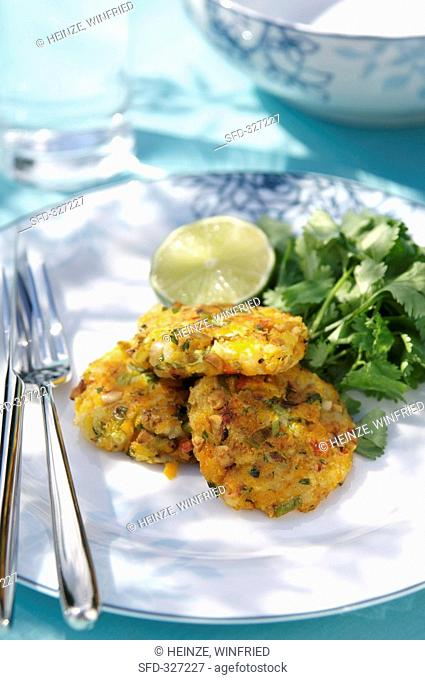 Three coriander potato cakes with chilli and lime