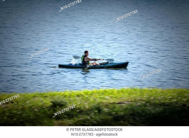 Man paddling a kayak