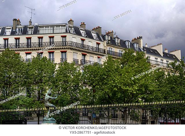 Luxembourg gardens fence and apartment buildings surrounding the park