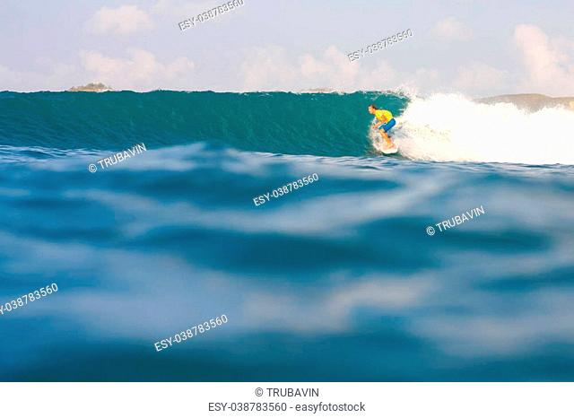 Surfing a Wave. Lombok Island. Indonesia