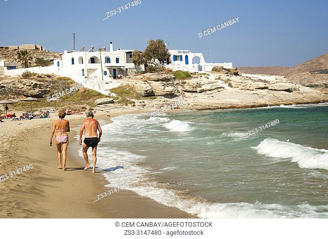 Elderly couple walking at the beach in Naoussa village, Paros Island, Cyclades Islands, Greek Islands, Greece, Europe