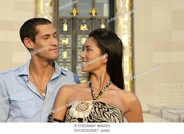 Inter-racial couple looking at each other