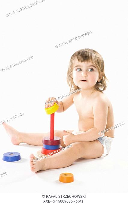 baby playing with education toy