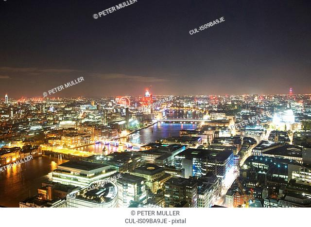 Cityscape of London and river Thames illuminated at night, United Kingdom, Europe