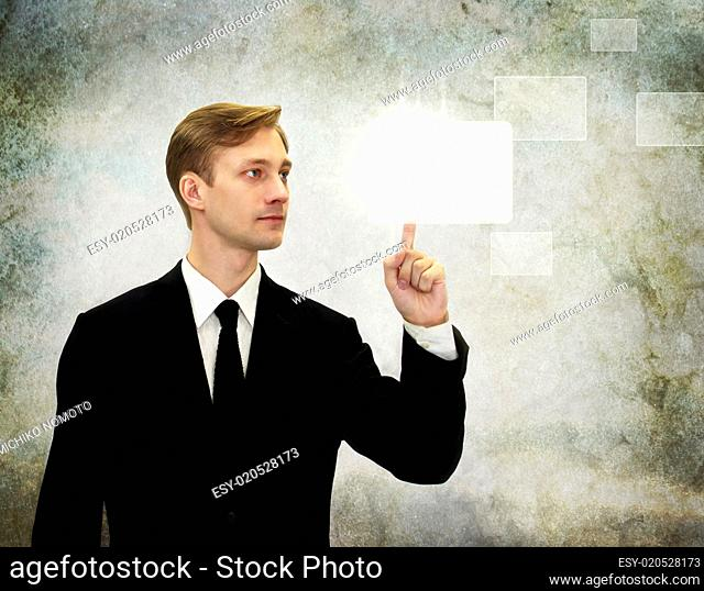 Business man pressing a touch screen