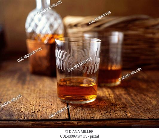 Glasses of whisky on table