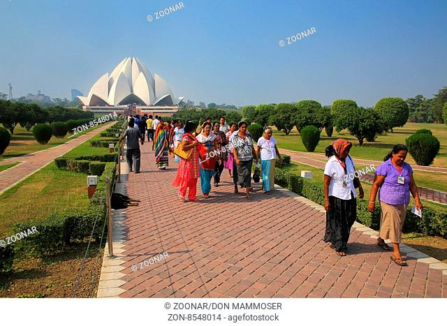 People walking to and from Lotus temple in New Delhi, India