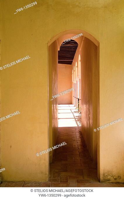Yellow interior with arched passage in the Alcazar,Seville,Spain