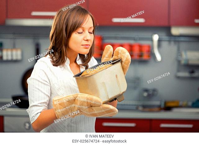 Young woman preparing homemade bread